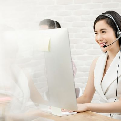 Beautiful Asian woman telemarketing customer service agent worki
