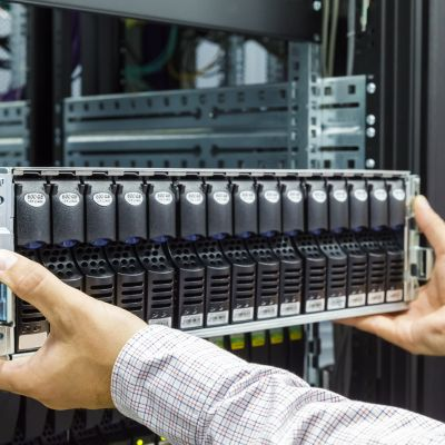 46945854 - it engineer installs equipment in the rack in datacenter